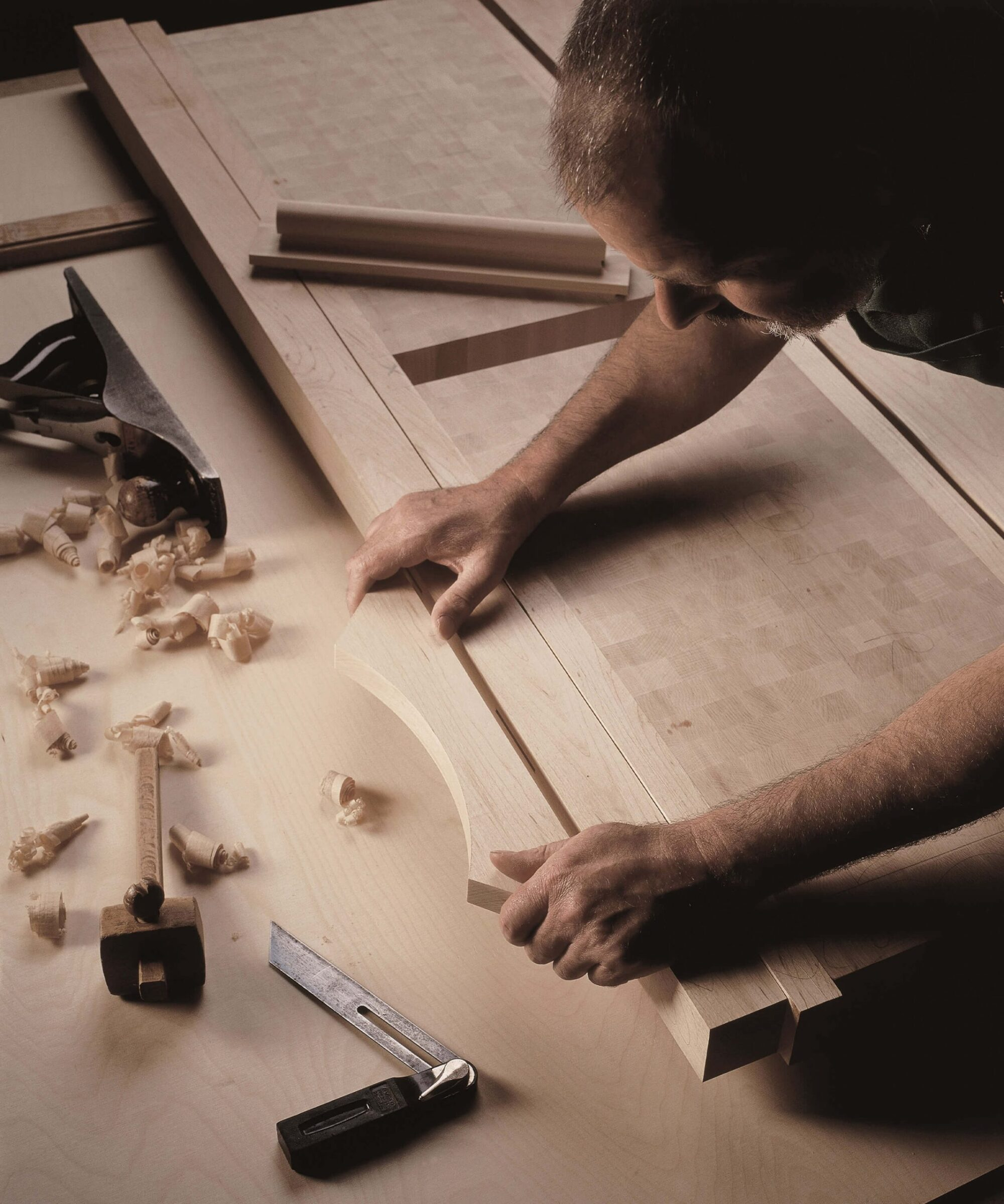 a handmade kitchen by Smallbone being crafted by a artisan craftsman