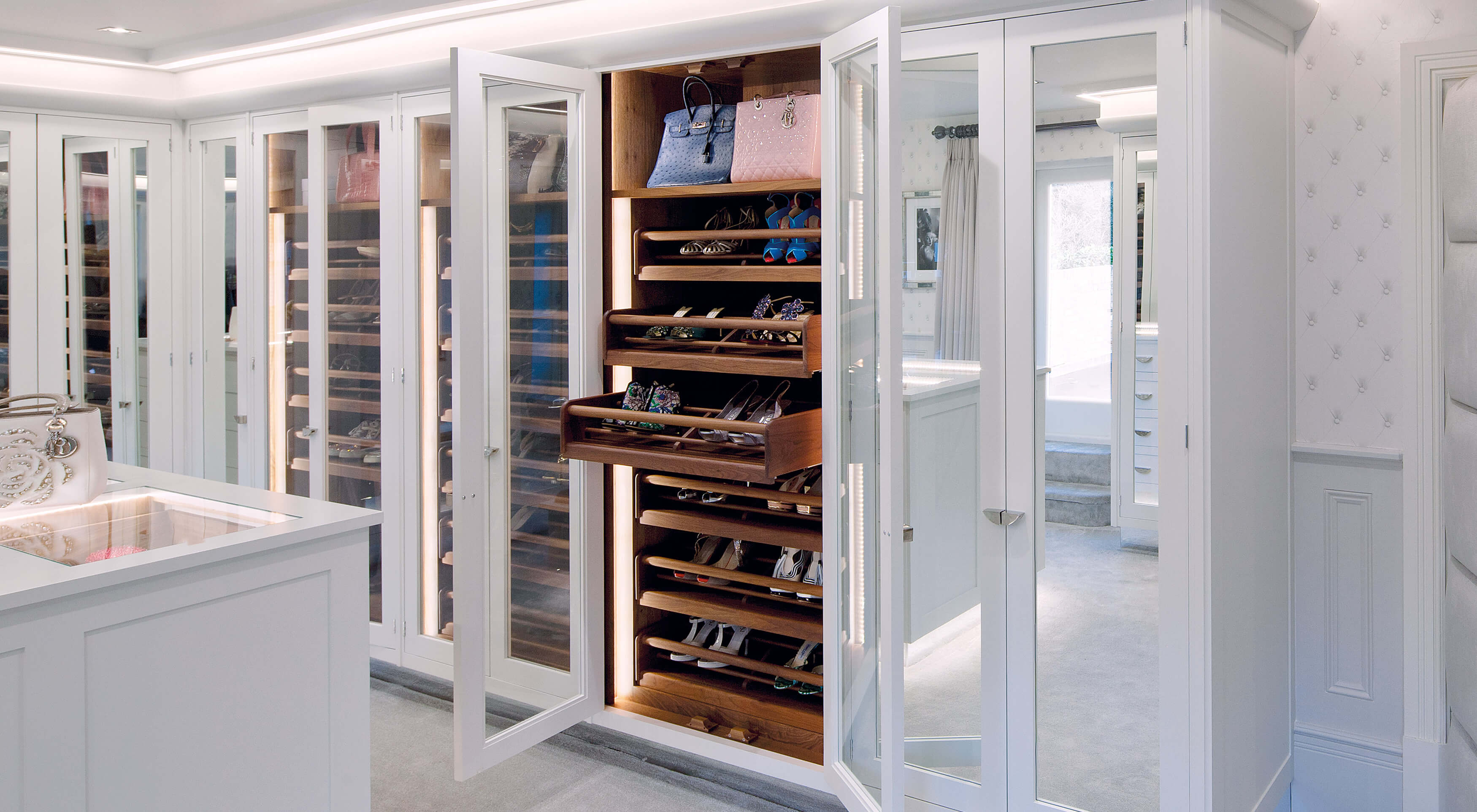 Bespoke white dressing room furniture by Smallbone