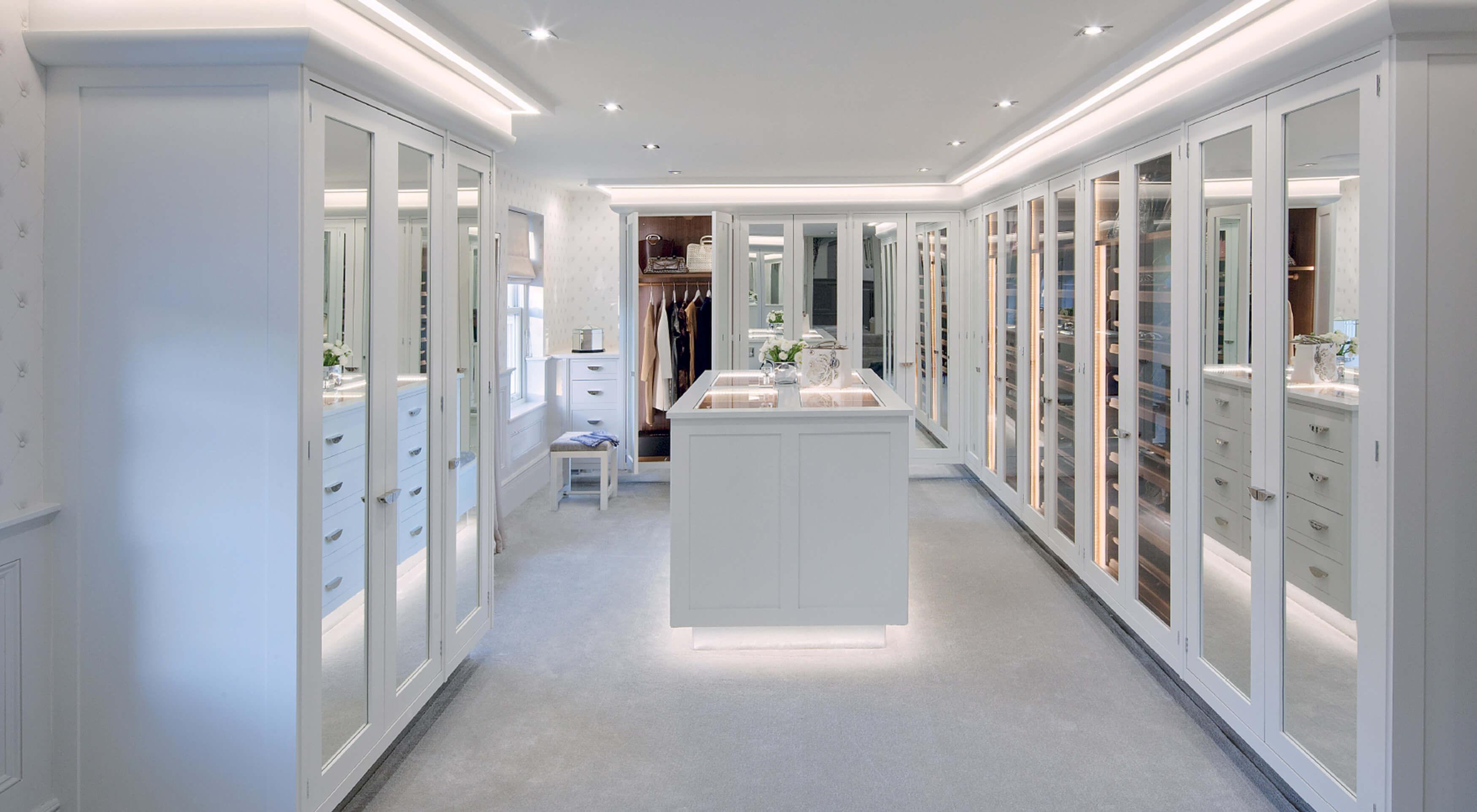 bespoke white walk in wardrobe furniture by Smallbone