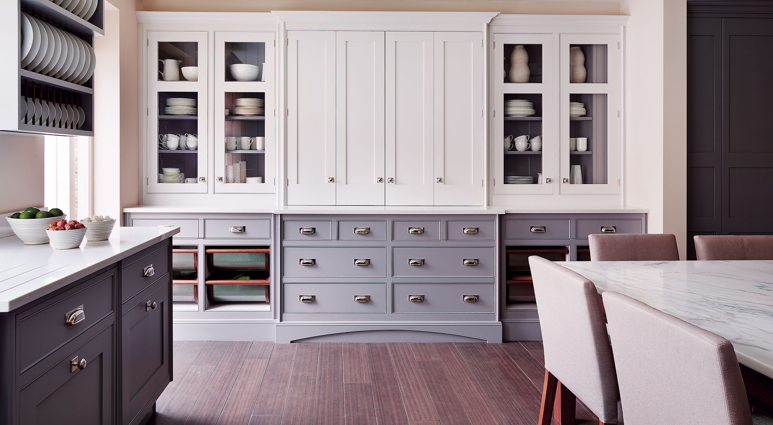 a Smallbone Iconic kitchen with upper cabinetry painted in white and lower cabinetry hand finished in grey