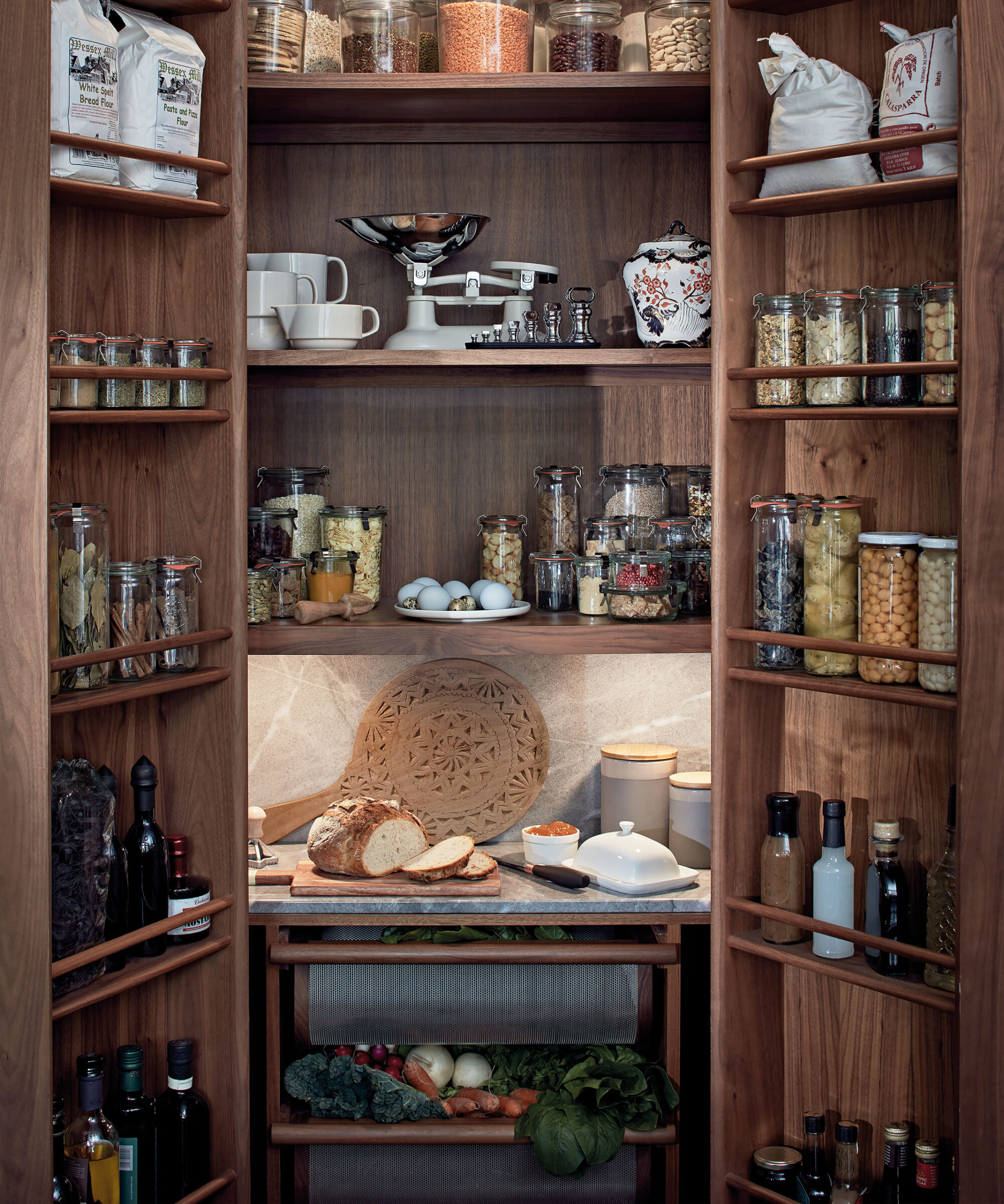 an open Smallbone larder with spice racks bottle racks and shelving