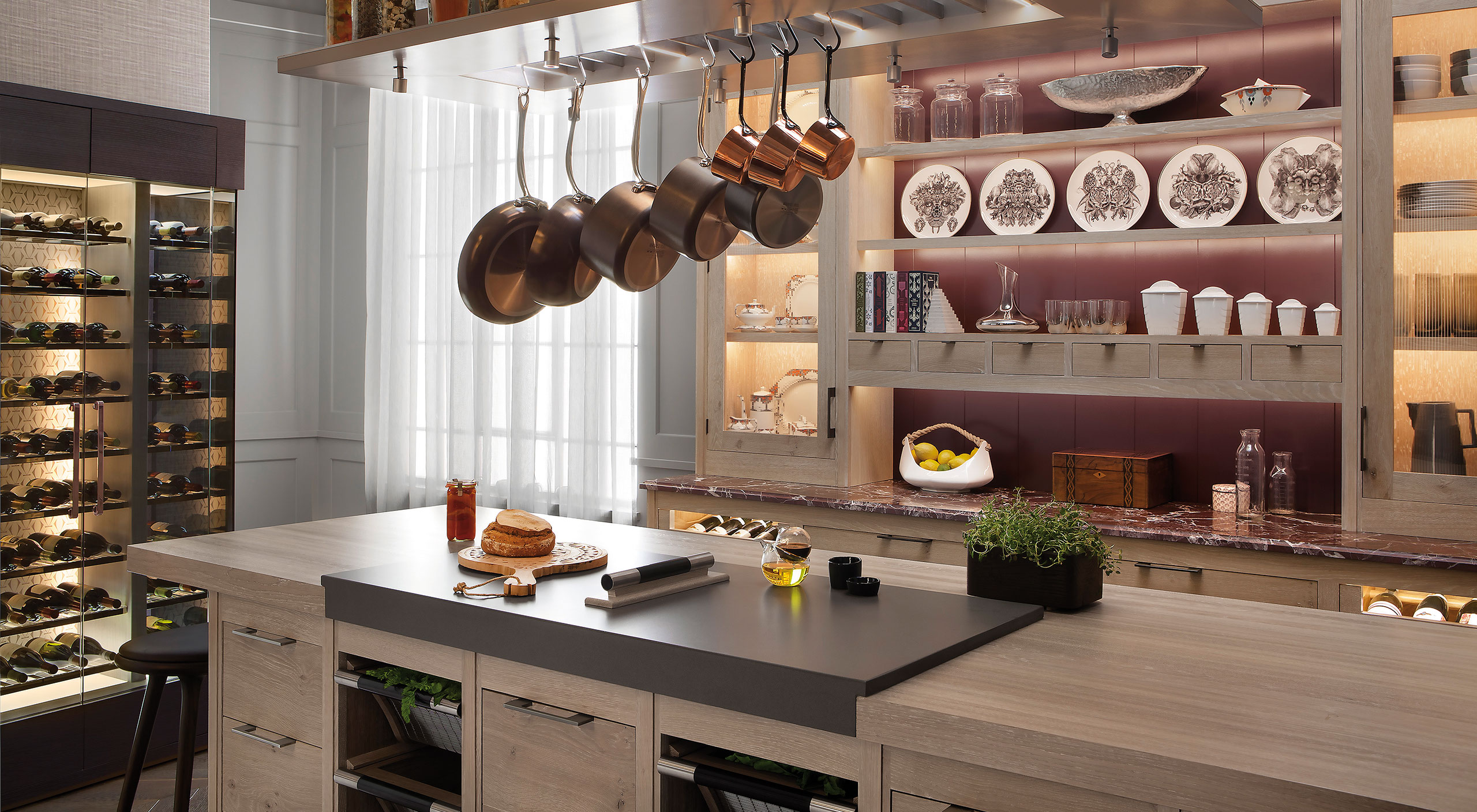 A Brasserie kitchen by Smallbone with bespoke wine wall