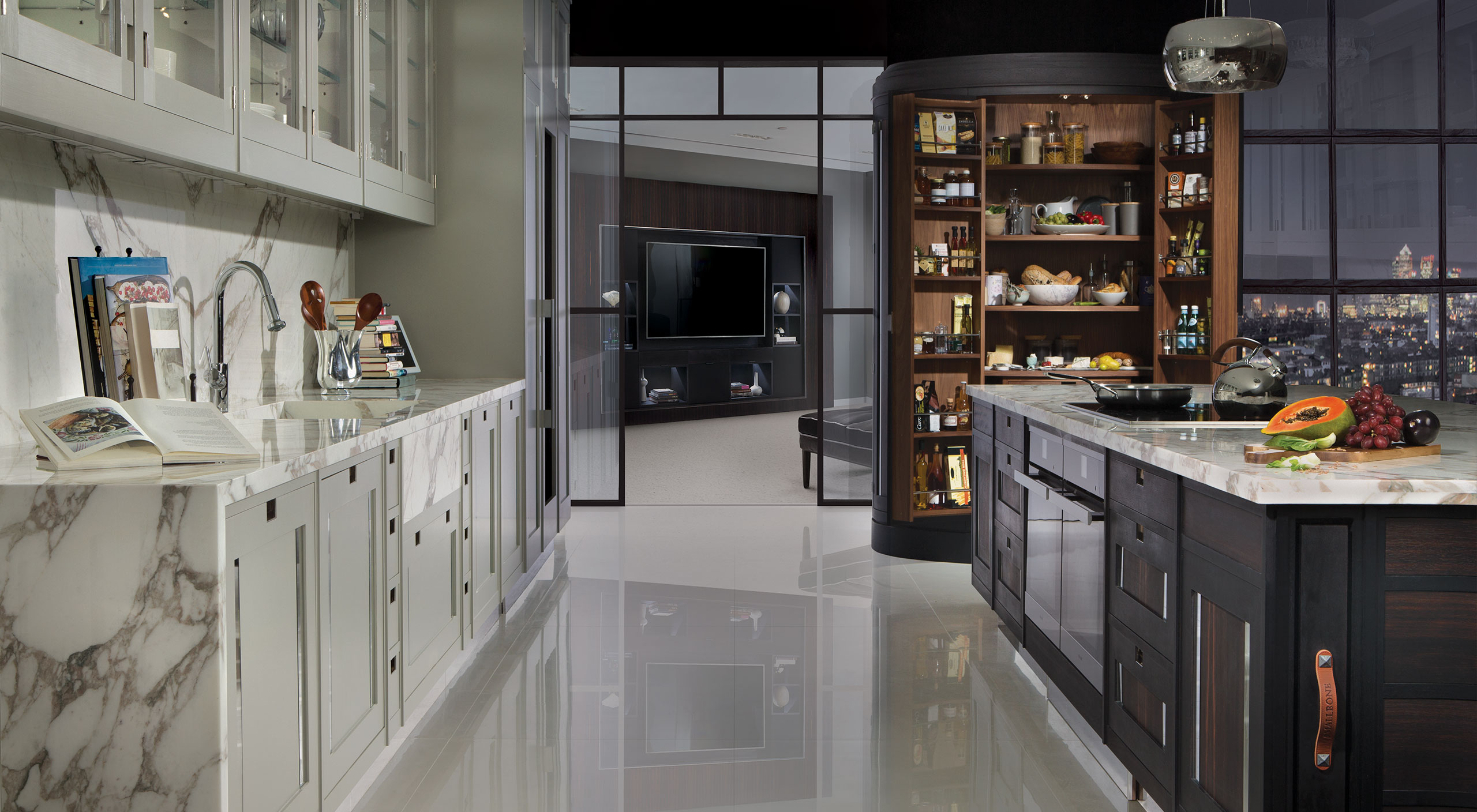 A Macassar kitchen by Smallbone with marble waterfall worktops and bespoke curved larder