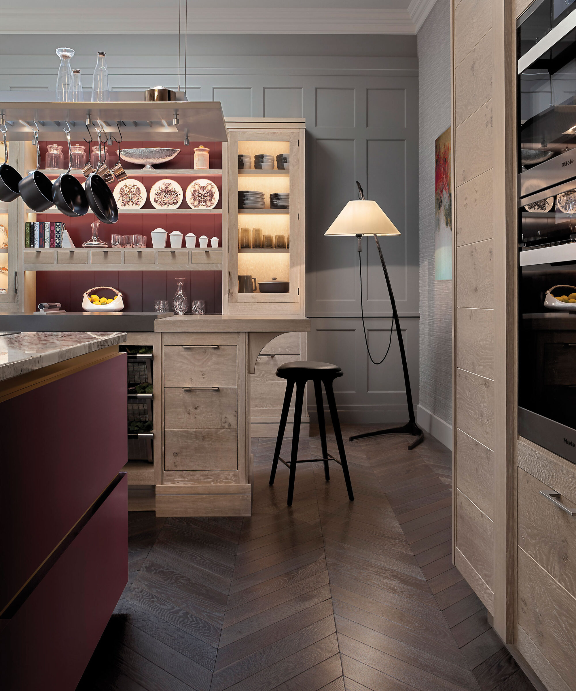 a smallbone brasserie kitchen with modernist central island in plum colour