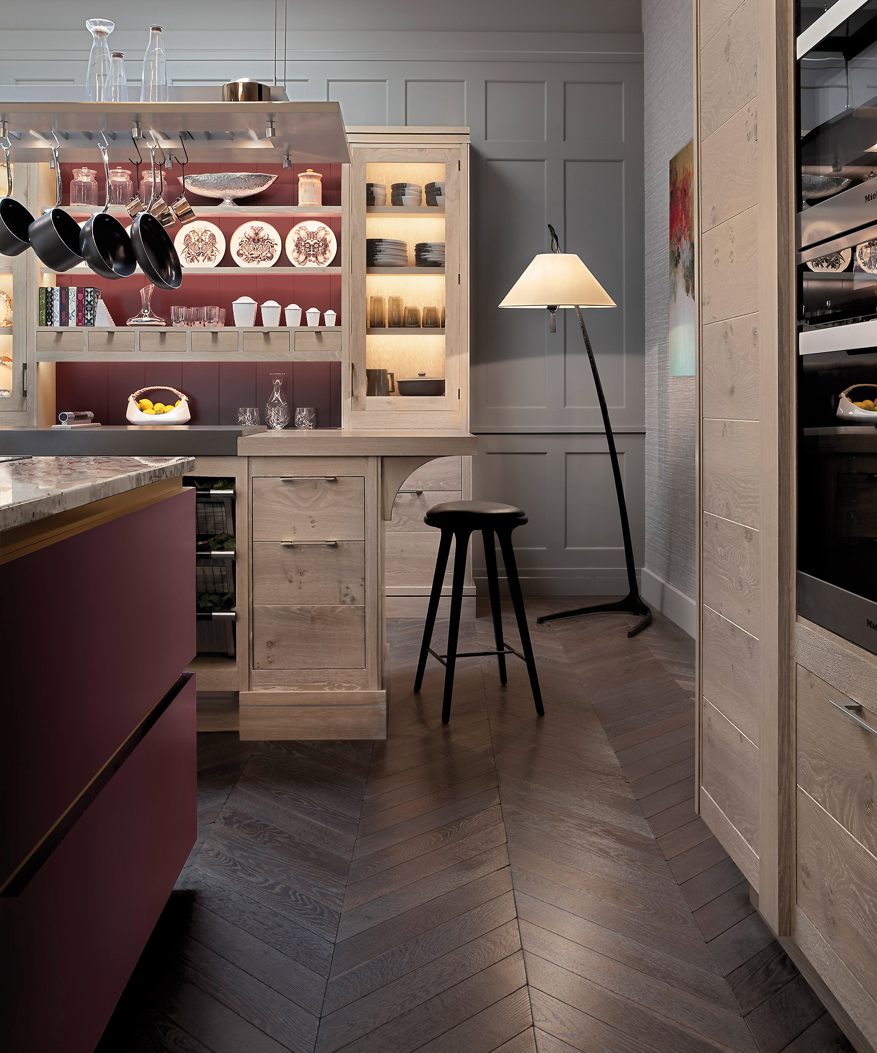 A Brasserie kitchen with plum coloured Modernist island