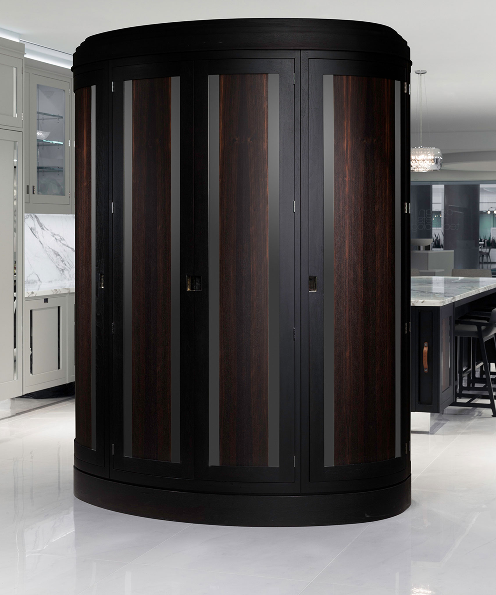 A curved Macassar Uber pantry by Smallbone with cabinet doors closed