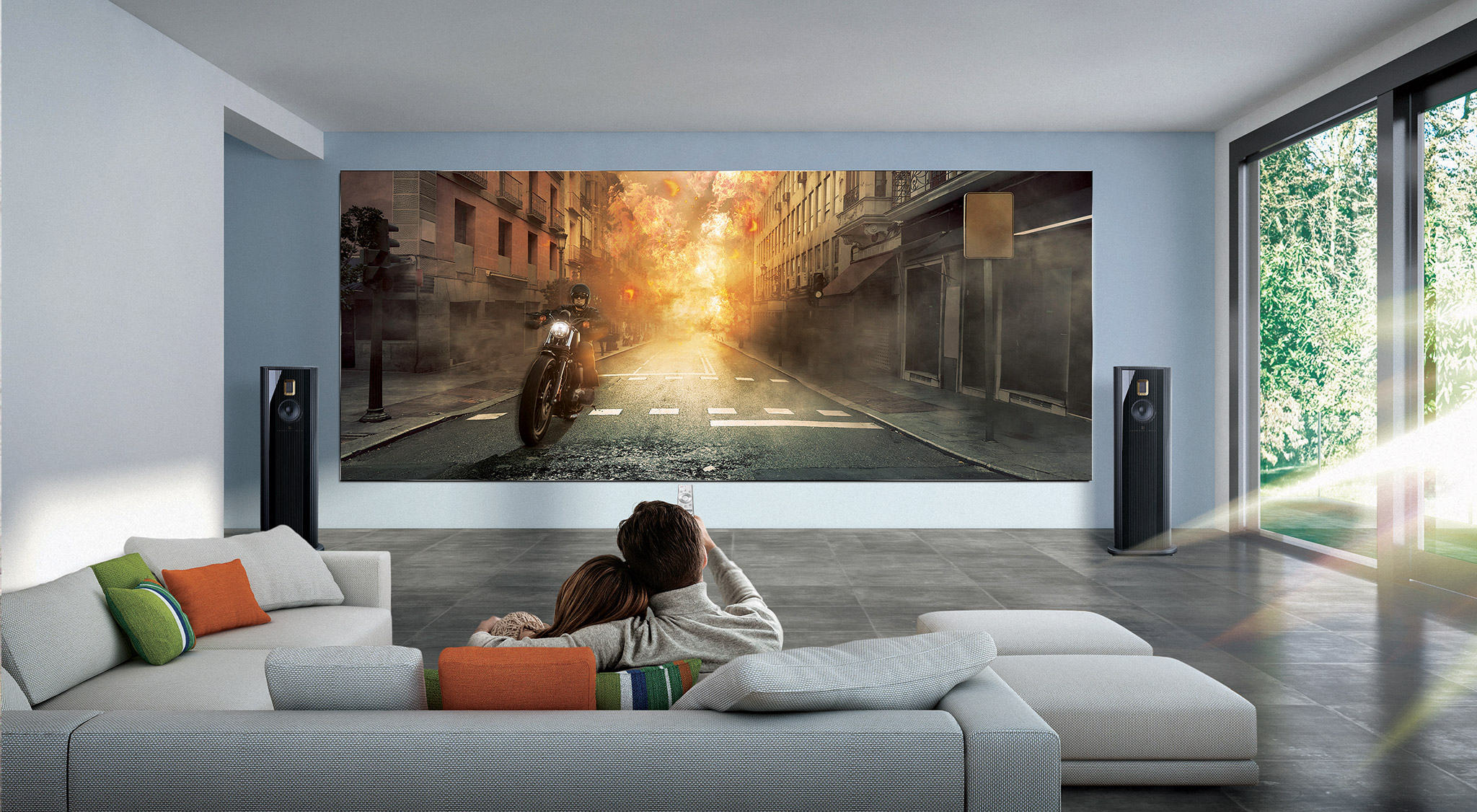 a couple at home watching a Samsung Wall television