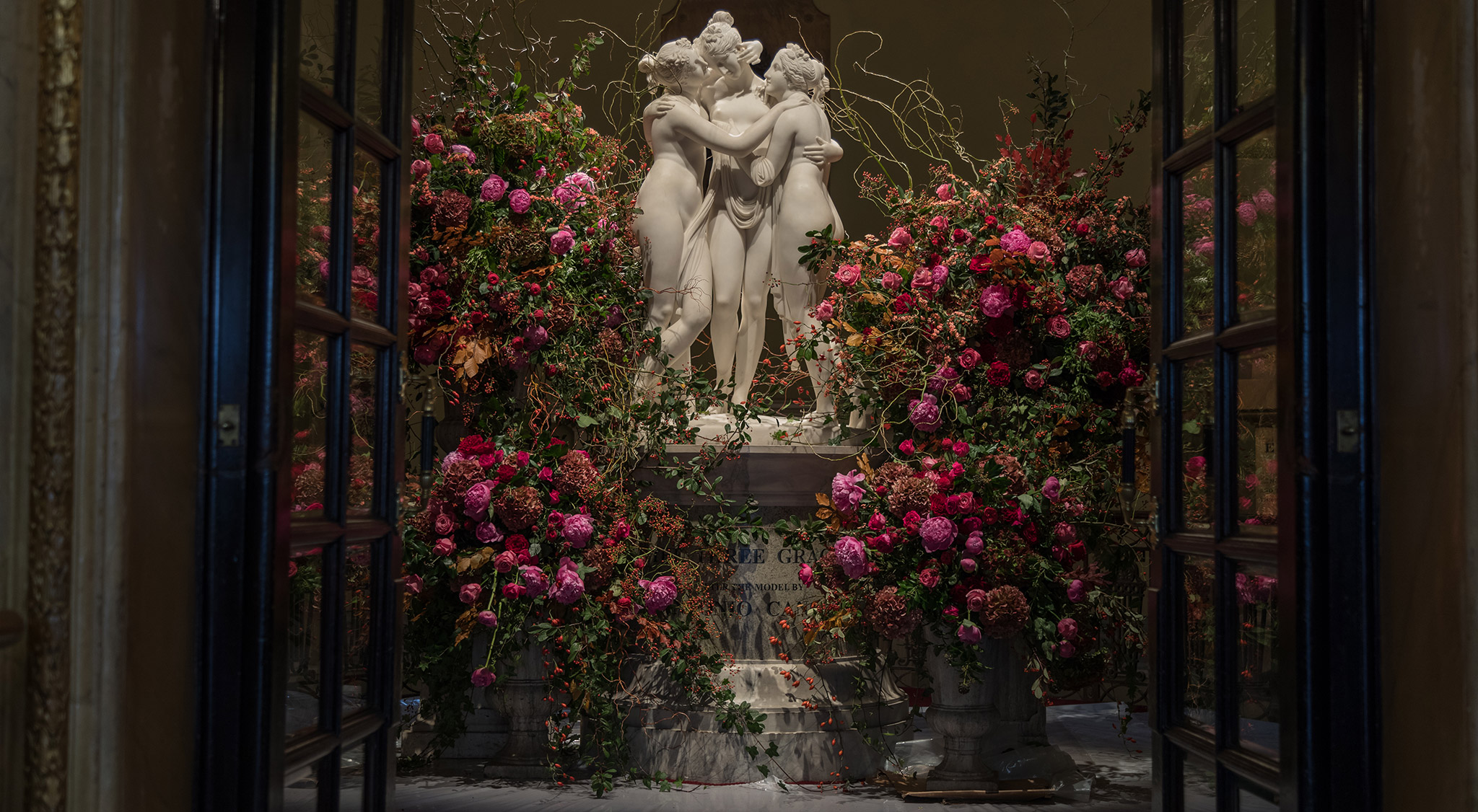 Mcqueens Flowers floral display with Greek statues