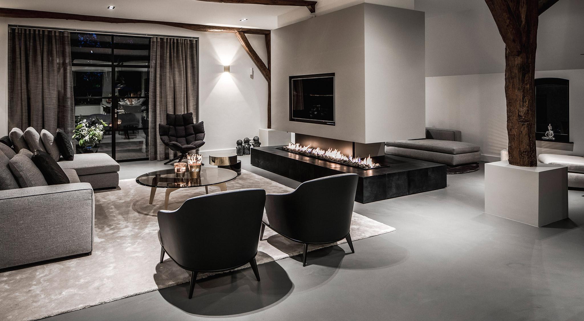 A sitting room with lit fireplace and a light grey Senso floor
